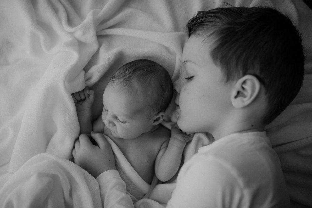 newborn and sibling in studio